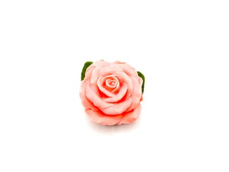 pink rose soap on white background.