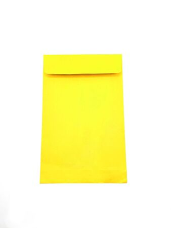 Yellow paper envelope on white background