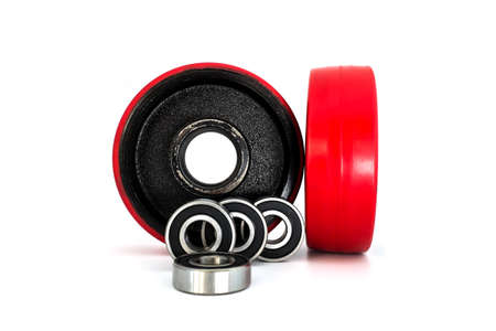 Red wheels and steel bearings isolated on a white background photo