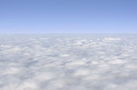A beautiful collection of clouds as seen out of a window of a Boeing Airplane