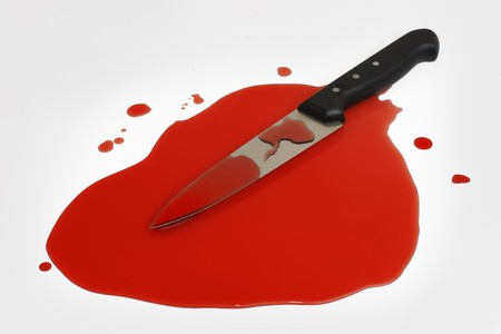 A sharp kitchen knife in a pool of blood.