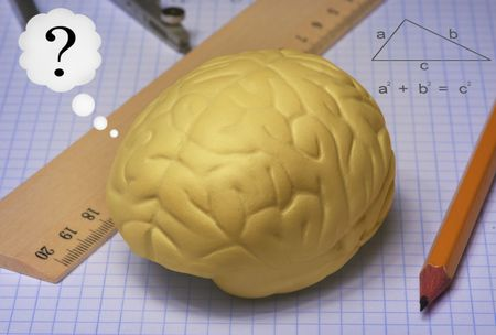 A human brain and geometry accessories Stock Photo