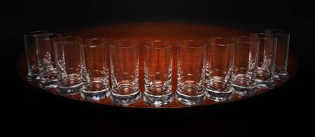 Tequilla glasses on the edge of a round table