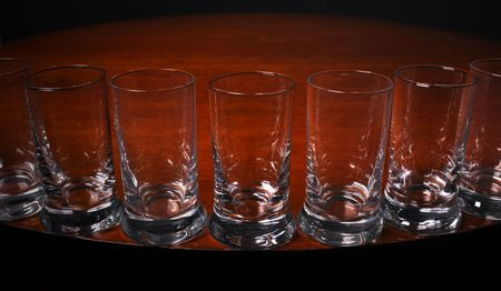 Close up of Tequilla glasses on the edge of a round table