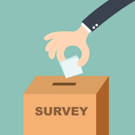survey concept - hand putting voting paper in the ballot box