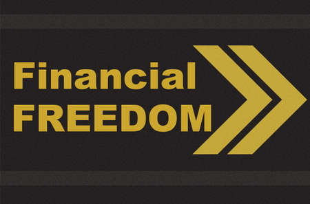 key to freedom: business concept - financial freedom written on the road