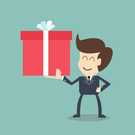 사업가 큰 선물 상자 크리스마스 선물을 들고