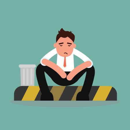 Depressed businessman sitting with street
