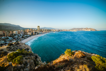 Breathtaking view of the coastline in Benidorm with high buildings, mountains and sea Stock Photo