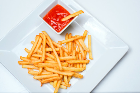 french fries plate: French fries with ketchup on a white plate Stock Photo