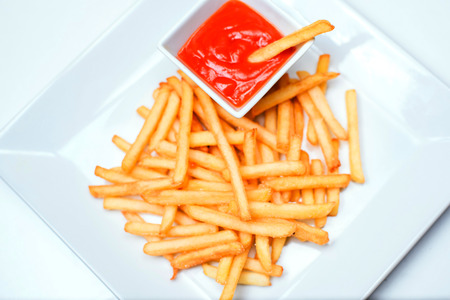 frites: French fries with ketchup on a white plate Stock Photo