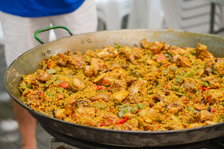 conceptional: Closeup of a traditional tasty spanish dish paella served with meat and vegetables Stock Photo