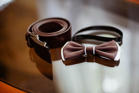 Closeup of a brown bowtie and belt Stock Photo