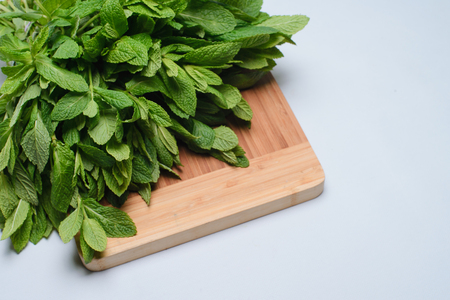 Bunch of a fresh mint on a wooden background