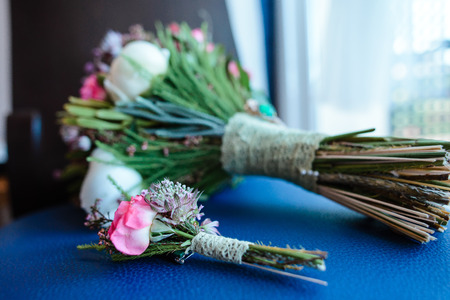 buttonhole: Wedding bouquet with pink flowers and buttonhole