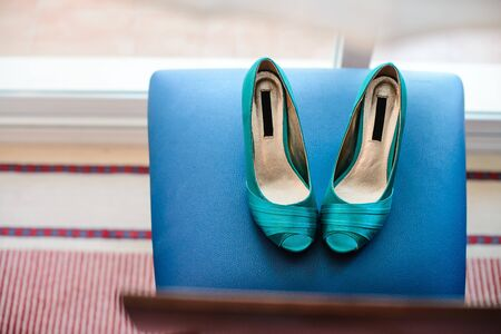 Blue wedding shoes on a blue background