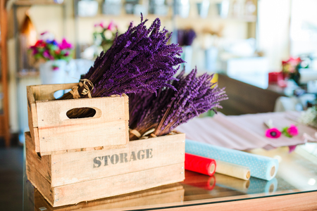 Close up of lavender flowers bouquet in the wooden box at a flower shop. Delivery of flowers. Creative floral sturio.