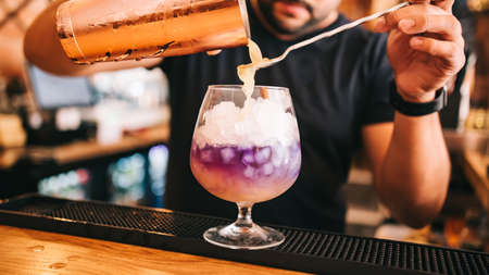 Beautiful alcoholic cocktails at a party, on the bar, vodka in glasses