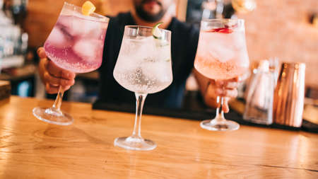 Beautiful line of multi-colored alcoholic cocktails at a party, on the bar martini, vodka in large glasses Zdjęcie Seryjne