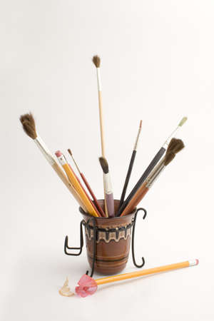 many brushes, pencil sharpener and drawing