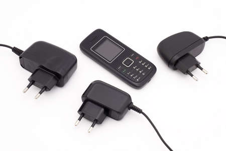 several chargers for mobile phone on white background