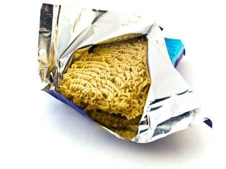 coeliac: Dried Egg Noodles in Foil on White Background