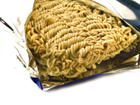 preperation: Dried Egg Noodles in Foil on White Background