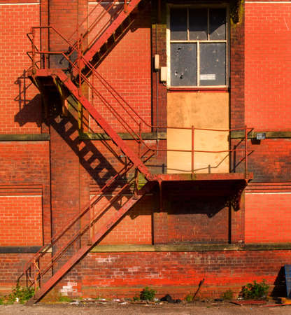 Rusty Old Fire Escape Stairs on Warehouse Stock Photo - 3264803