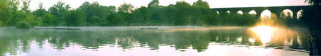 Panoramic View of Misty Pond and Brick Viaduct In British Summer Morning Stock Photo - 3264819