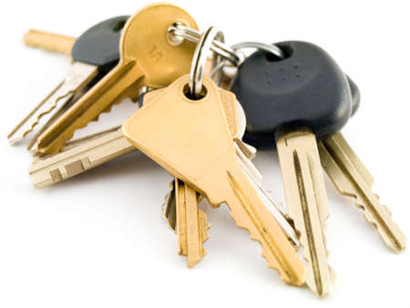 Set of  and Vehicle Keys on White Background