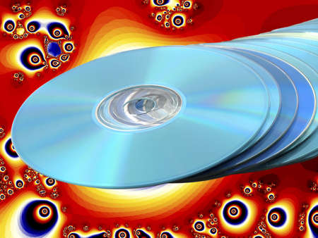 CDs DVDs Blu-ray Stack of Blue Disks Discs with Psychedelic Bright Orange Fractal Background Stock Photo