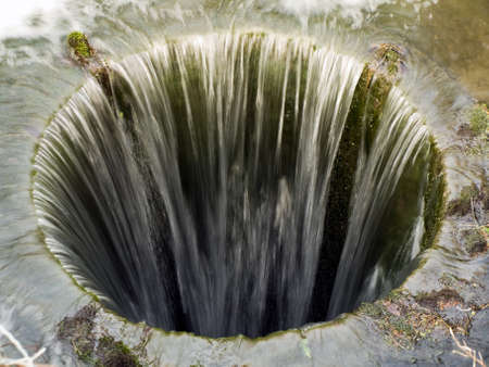 Deep Bottomless Pit with Water Flowing In