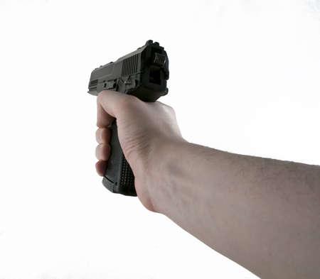 Hand Holding Aiming Slingshot Black Pistol photo