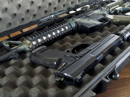 foam safe: Guns in Soft Secure Storage Case Stock Photo