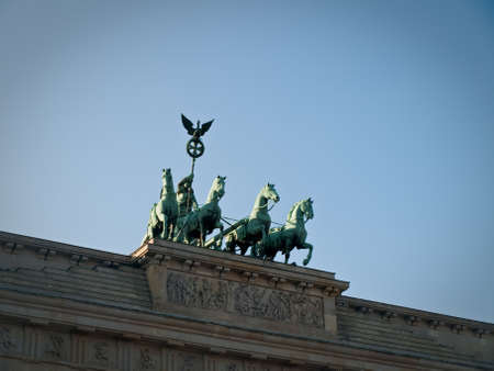 surmounted: Front View of Brandenburg Gate Quadriga Chariot Statue with Sky Copyspace