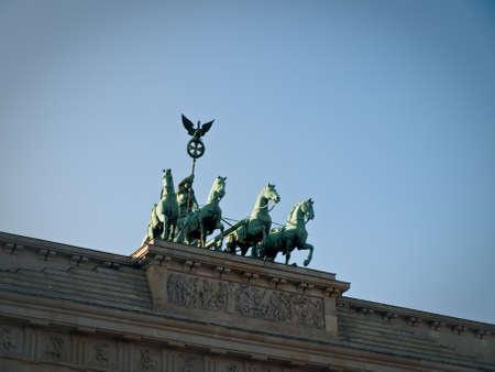 quadriga: Front View of Brandenburg Gate Quadriga Chariot Statue with Sky Copyspace