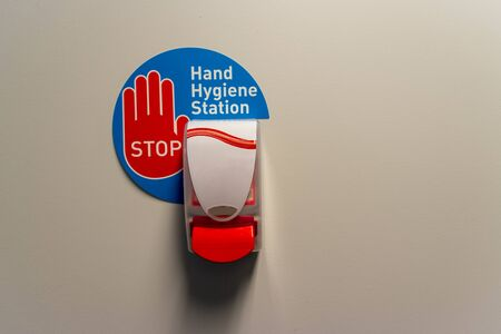 hand hygiene station on a wall in a hospital