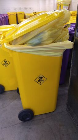 yellow infectious hospital bins , from coronavirus pandemic