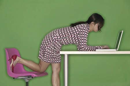 Woman working on laptop Stok Fotoğraf