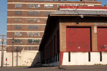Abandoned warehouses in New Jersy with graffit on loading dock doors