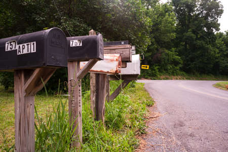 Row of unique mailboxes in rural USA town. Фото со стока