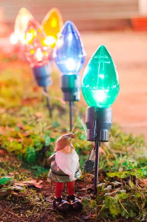 chrstmas: Garden Gnome with Chrstmas lawn lights Stock Photo