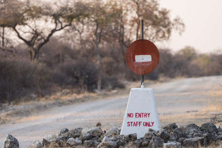 Hand painted no entry sign along road in Etosha National Park, Namibia Фото со стока