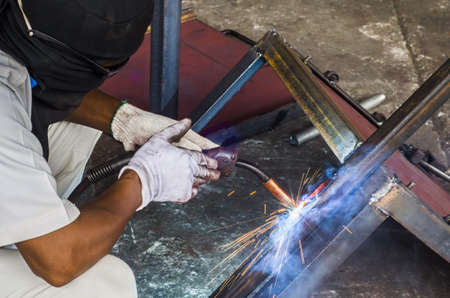 requires: Welder profession requires expertise. Stock Photo