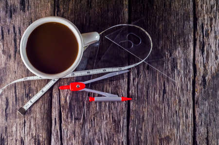 adds: Drawing tools and coffee adds power to work. Stock Photo