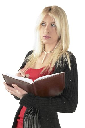 Business women with agenda in hands. Writing schedule. Stock Photo