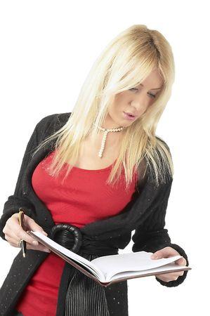 Blond girl reading agenda