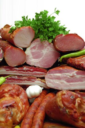 Various smoked meat decorated with parsley Stock Photo