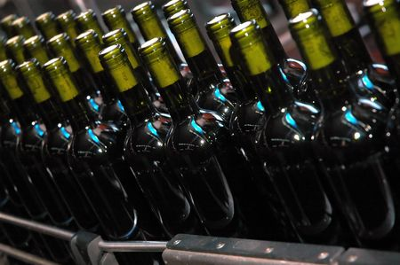 Bottles in line. Wine factory. Preparing for sale. Stock Photo - 942695