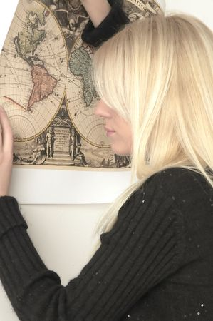 Blond girl learning about world photo